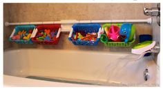 Mount an extra tension shower rod right next to the bathtub and use s-hooks to hang plastic baskets. | 40 Smart Tricks To Keep Your Kids Organized
