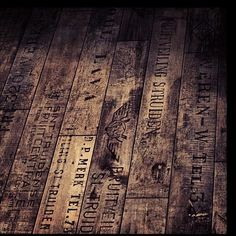 Repurposed floor with text. Could be interesting for a foyer or laundry room.