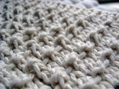 """I am loving this as a spa washcloth for the massaging quality of the """"pebbles."""" Mmm. On a less indulgent note, the pebbles are also good for scrubbing dishes. *sigh* Pebble Cloth Yarn: Dishcloth cotton, e.g., Sugar 'n Cream from Lily Needles: Size 6 or your favorite for dishcloths Cast on 36 sts. Knit all …"""