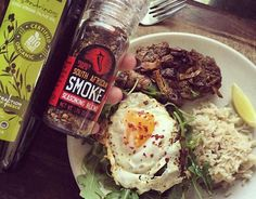 Check out this amazing meal idea featuring 4oz of lean steak seasoned with #traderjoes South African smoked spices, cooked with a spray of @kasandrinos olive oil and a clove of garlic,served with brown rice, arugula, one whole egg,and a squeeze of lime for some extra kick. If you want healthy meal ideas that aren't boring built into a convenient, yet affordable meal plan check out gaugegirltraining.com TODAY!