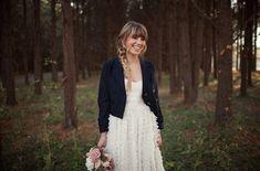 A dark blazer over a wedding dress | 30 Wedding Cover Ups to Keep Warm on Your Big Day via Brit + Co.