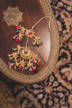 Wedding Kaleere - Gold and Multi-colored Pom Pom Kaleere | WedMeGood #indianbride #wedmegood #indianwedding #kaleere #gold #artsy
