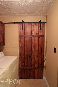 DIY Sliding barn door for under $100!!!  I found this post after doing a lot of research.  Just to buy pre-made sliding hardware is hundreds of dollars, which didn't include the door.  This is an amazing replica for cheap.  Absolutely doing this!!