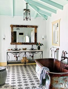 Sink fittings by California Faucets and handmade floor tiles add charm to a guest bath at Celerie Kemble's Dominican Republic retreat. Architectural Digest, Celerie Kemble, His And Hers Sinks, Cleaning Painted Walls, Glass Cooktop, Vogue Living, Simple Life Hacks, Dominican Republic, Bathroom Inspiration