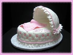 "- Inspired by the photo that the client sent me and several models found in CakeCentral.com To celebrate the baby shower for Nichole, a delicious cake filled with dulce de leche. An oval cake of 13.5 x 12.4 in x 3 in.. Cover with "" Satin Ice rolled Fondant "" and gumpaste accents as beautiful lace ruffles, ropes, ribbons, bows and small flowers in shades of pink, with some pearl dragees. Accompanied by a beautiful blanket emblazoned with quilting, with a bunny, a teddy bear and t…"