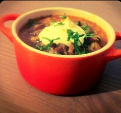 "Spicy ""chorizo"" three bean chili with orange saffron cream and cilantro"