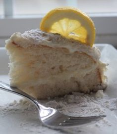 Olive Garden Lemon Cream Cake is just like what you love at the restaurant! Olive Garden Lemon Cream Cake Recipe is super easy to make at home and tastes amazing! Olive Garden Lemon Cream Cake Recipe, Lemon Creme Cake, Cream Lemon, Olive Garden Recipes, Lemon Desserts, Lemon Recipes, Copycat Recipes, Just Desserts, Delicious Desserts