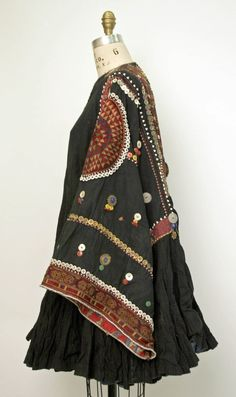 A 20th century  Wedding Tunic from Central Asia Afghanistan (side view) - cotton, metal, plastic, mother of pearl  http://thursdayofravens.tumblr.com/post/47857286775/76945-costume-research-and-more-a-20th-century