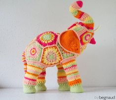 Hand crocheted elephant soft sculpture approximately 20 inches tall and 16 inches long. Pink, green, yellow, and orange yarn crocheted around an elephant shaped figure. Crochet Teddy, Cute Crochet, Beautiful Crochet, Crochet Crafts, Crochet Yarn, Yarn Crafts, Hand Crochet, Crochet Flowers, Crochet Hooks