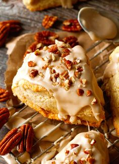 Maple Nut Scones - these scones are so buttery, flaky and will melt-in-your-mouth! Topped with a luscious Maple Glaze and Chopped Pecans.