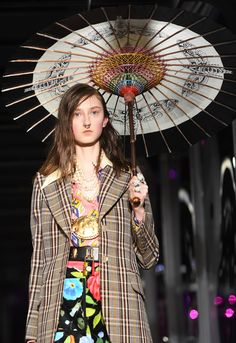 7 Things We Learned from the Gucci Fall 2017 Runway - A Great Umbrella is a Great Accessory from InStyle.com