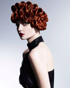 Intricate, copper-toned bows make up this fabulous updo from Francesco Group Cheltenham's Lisa Walby. Wales and South West Hairdresser of the Year Finalist 2014!