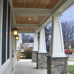 Wooden ceiling on porch with craftsman pillars with stone