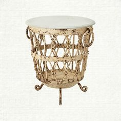 designed with the image of old drums in mind, our marble top iron side table stands distinctly in any room. the mottled cream finish has just enough c