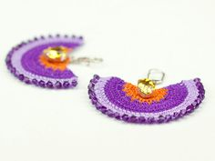 Heavy on the details, feather light to the ears!    These boho chic earrings are handmade with semi color crochet lace, Swarovski Elements Crystals