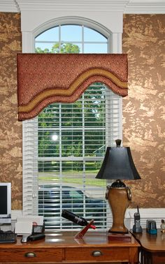 Exaggerated Arched and Banded Cornice Window Treatment.