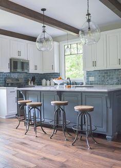 The Decorologist kitchen design - blue subway tile, blue island, modern farmhouse, blown glass pendants