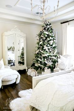 Deck the Halls! Elegant white master bedroom with snowy white Christmas tree
