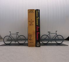 Metal bicycle bookends.