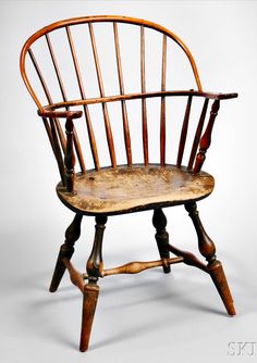 Skinner's - The Personal Collection of Lewis Scranton, Auction 2897M. May 21, 2016. Lot: 60. Estimate: $4,000-6,000. Realized: $6,500. Description: Green-painted Bow-back Windsor Armchair, probably Guilford, Connecticut, c. 1770-80, with vase- and-ring-turnings and shaped saddle seat, ht. 35 1/2 in. Provenance: Hubbard House, Guilford, Connecticut, 1971. Antique Chairs, Antique Furniture, Furniture Decor, Victorian Home Decor, Victorian Homes, Guilford Connecticut, Early American Furniture, Southern Furniture, Dining Chairs