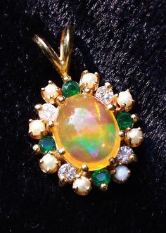 Mexican opal with diamonds, emeralds, and pearls