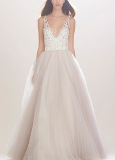 Glittering embellishments illuminate the neckline and fitted lace bodice of this enchanting silk gown that finishes with a voluminous A-line skirt of layered tulle for an utterly romantic look.