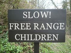 Slow! Free Range Children (at Castle Combe, Wiltshire) by dullhunk, via Flickr