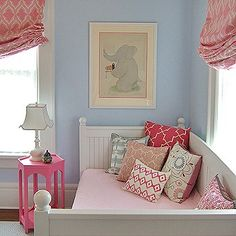 Mix of raspberry red/pink with blues. Note mix of white furniture and pops of color :) Love the roman shades!