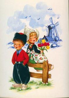 Dutch Boy and Girl sitting on a fence