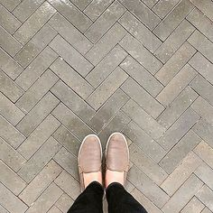 Concrete tiles from cle tile in a herringbone pattern...swoon!