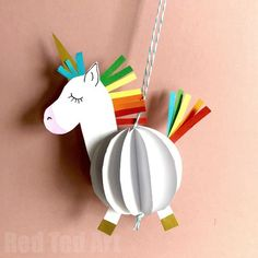 Easy 3D Paper Unicorn Decoration - Awww paper crafts for kids are so fun and so easy. All you need for these OH SO CUTE 3D Unicorn Baubles, is one sheet of A4 paper and some scraps of coloured paper (or some pens!). Alternatively make use of our handy free printables - there are 3 versions - templates, colour yourself or CUT and ASSEMBLE. Just so CUTE! Love. #Unicorn #unicorncrafts #unicorndiys #paperunicorn #unicorndecoration #printable #templates
