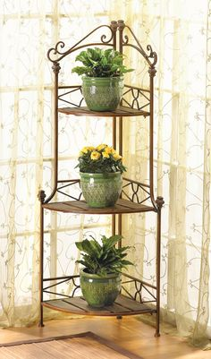 Tuck this lovely shelf into a drab corner, add your favorite collectibles or plants, and you've got an instant designer display! Warm wood tones and ornamental scrollwork add timeless style.
