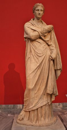 Herculeneum woman. Athens, National Archaeological Museum, 2009 It is a funerary marble statue, a copy made in the 2nd century B.C. of a famous original dated from about the 300 B.C. She wears a full-length chiton and a himation that covers the entire body and arms. It was found on Delos.