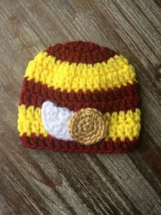 Get your future Hogwarts witch or wizard ready for their acceptance owl with this adorable little crochet hat in Gryffindor colors and a