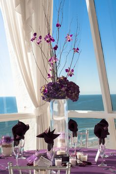 Purple lavender wedding.  Grand Plaza Resort tall wedding centerpieces purple Hydrangeas and orchids.  www.grandplazaflorida.com