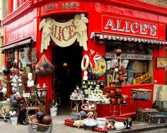 would love to muck around in there....love the Alice sign...Portobello Road - London