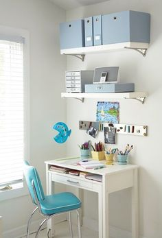 Don't have enough room for a home office? How about a little office corner? Add storage bins to floating shelves to get clutter and files off the ground. Keep things neat with a few canisters for pens and what nots.