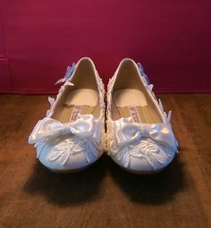 Beautiful flat wedding shoes, hand decorated with lace, pearls and ribbons.  These will guarantee your feet look beautiful, without making