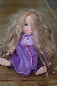 Caring for Doll Hair - This is amazing.  I was just brushing Rapunzels hair last night.  Her's isn't as bad as this, but I can see it coming since Becca likes to drag her by her hair!