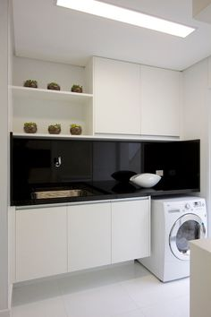All white laundry with black glass splashback. #laundry #white #glasssplashback