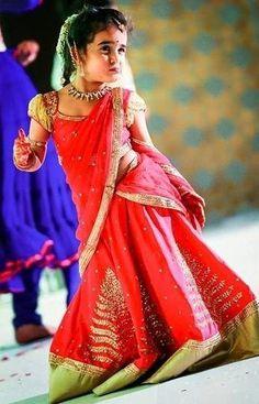 Baby in Bhargavi Kunam Half Saree - Indian Dresses Girls Frock Design, Baby Dress Design, Kids Frocks Design, Kids Saree, Kids Lehenga Choli, Sarees, Wedding Dresses For Kids, Little Girl Dresses, Girls Dresses