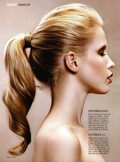 ponytail - wavy, band-covered, teased on top.