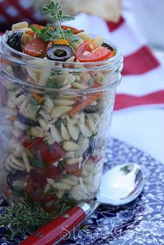 pasta salad in a jar...guess Im liking serving 4th of July food items in a mason jar...