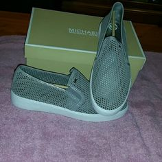 Michael Kors slip on sneaker very comfortable Perforated suede upper.Slip-on design.Dual gore panels for easy on-and-off.Rounded toe.Signature logo detailing.Synthetic lining.Lightly padded footbed.Rubber outsole.Imported.Measurements:Weight: 11 oz Women's sizesFeatured in greySlip-onGores on sides for easy on/off Laser cut-out designSport suede upperImported Michael Kors Shoes Sneakers