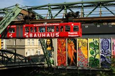 Wuppertal, North Rhine-Westphalia, Germany; mural and extremely crowded monorail car
