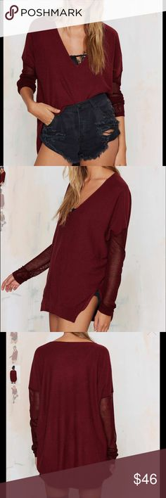 #335🦁🎃 So. Freaking. Soft. The Piper Sweater is burgundy and features a v-neck, knit sleeves, asymmetric hem, ribbing at edges, and oversized silhouette. Looks great with ripped black skinnies, loafers, and thin gold rings. By Glamorous.  *Nylon/Acrylic/Viscose/Wool  *Runs true to size  *Model is wearing size small  *Hand wash cold  *Imported Nasty Gal Sweaters