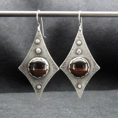 'Walk With Beauty' Red Tiger Eye and Sterling Silver Earrings Red Tiger Eye is said to increase personal power and the ability to manifest one's desires. #SilverJewelry