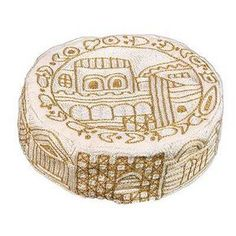 Hand Embroiderey Hat - Jerusalem in gold of $39.00 only. This beautiful hand embroidered hat is sure to be a conversation starter. The golden Jerusalem motif is embroidered using silk threads on cotton. It is a great gift for Bat Mitzvah, friends or family.  Visit http://yarmulkes.com/system/scripts/results_big.cgi?product=HAE-2 for more info