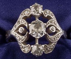 Antique Diamond Ring, prong and bead-set with old mine-cut diamonds, approx. total wt. 1.20 cts., silver-topped gold mount, size 8 1/4.  Estimate $500-700