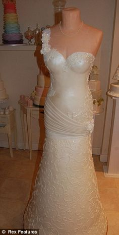 How DO you slice this one up? Incredible bridal gown wedding cake has 17 tiers, 22 kilos of sugar paste and feeds 2,000 people. Donna Millington-Day from Staffordshire was inspired by 6-year-old daughter's drawing. Completed cake in one week  Made from 17 tiers of sponge cake, 22 kilos of sugar paste icing, 2lb of royal   icing and hundreds of sugar pearls  Feeds 2,000 guests and will go on display at National Wedding Show. Britain